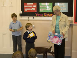 Rowen and Matthew receiving their prizes
