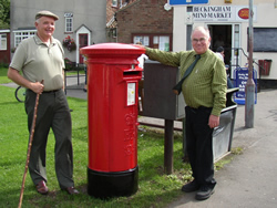 Post Master David Lewis and Parish Council Chair Henry Gourley 2005 with new post box